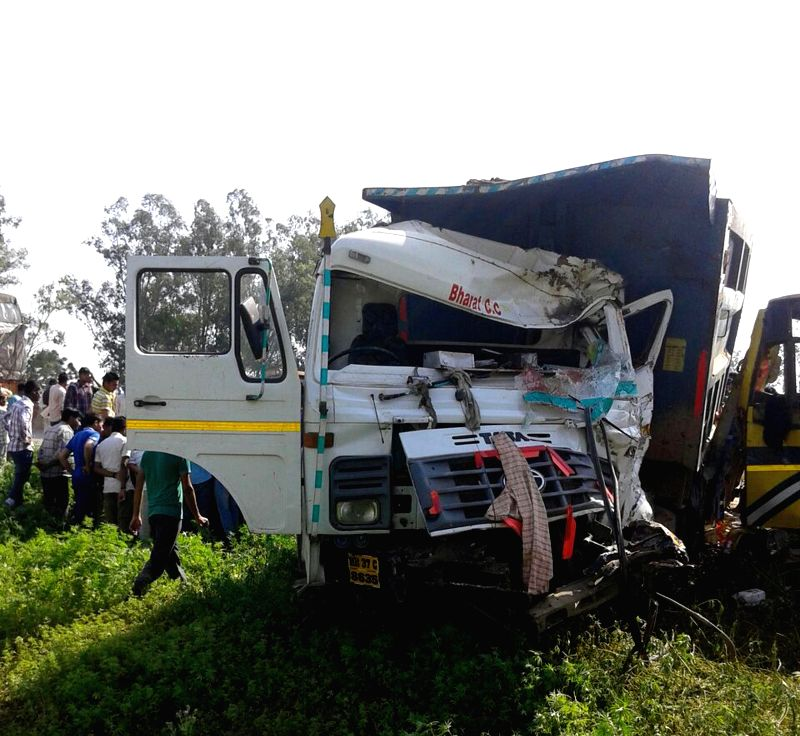 The mangled remains of a truck that met with an accident near Saha-Shahzadpur road in Ambala district of Haryana, on March 31, 2015. Five lecturers and two students of a private engineering ...