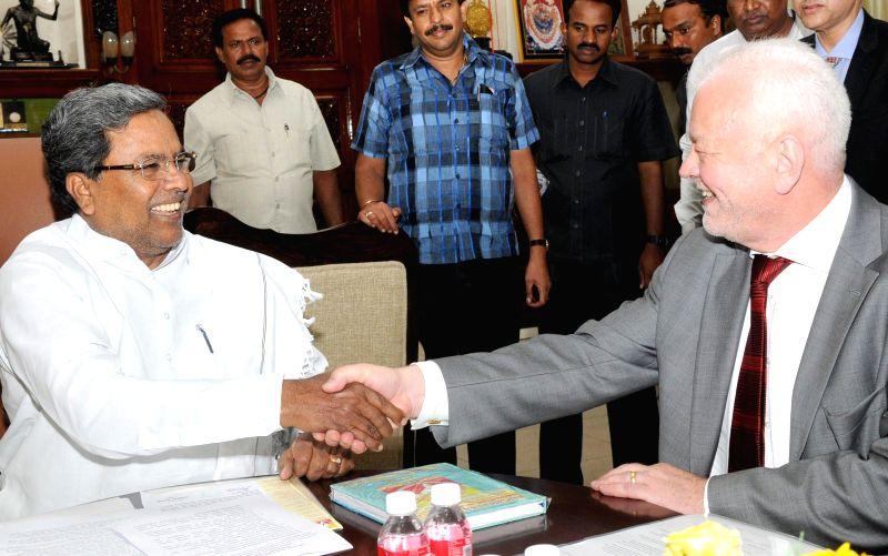 Ambassador of Sweden to India Harald Sandberg during a meeting with Karnataka Chief Minister Siddaramaiah at Vidhana Soudha in Bangalore on July 1, 2014. - Siddaramaiah