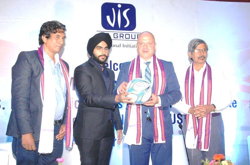 American Democrat Robby Wells and JIS Group Director Simarpreet Singh during a programme in Kolkata, on Oct 12, 2017. - Simarpreet Singh