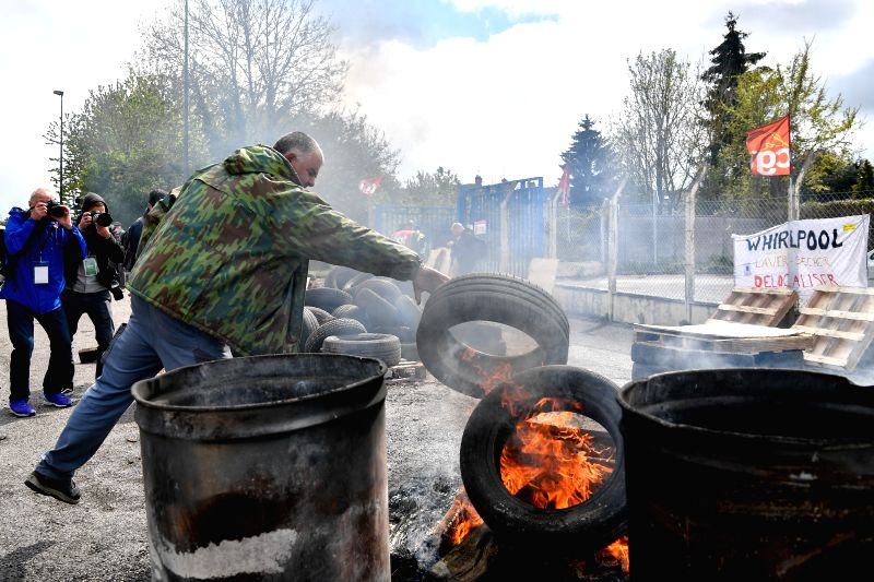 AMIENS, April 27, 2017 - A protestor burns tyres in front of the entry of the Whirlpool factory in Amiens, France, on April 26, 2017. Three months ago, the Whirlpool Corporation announced that it ...