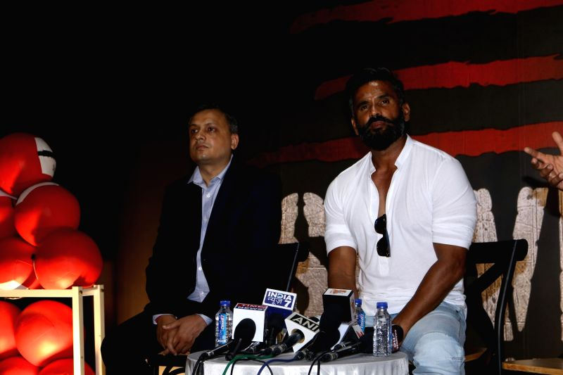 Amit Singh, GM, Smaaash, Bollywood actor Suniel Shetty during the launch of a gym in Mumbai on May 17, 2017. - Suniel Shetty and Amit Singh