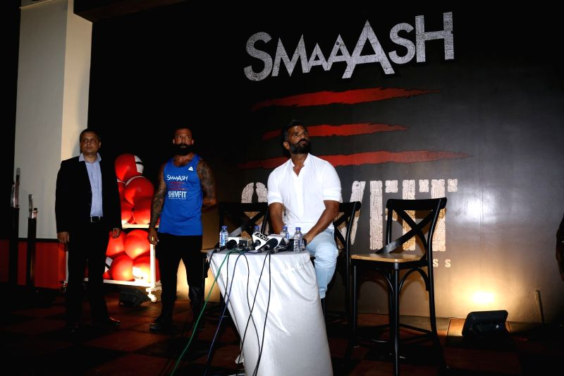 Amit Singh, GM, Smaaash, Bollywood actor Suniel Shetty and fitness trainer Shivoham during the launch of a gym in Mumbai on May 17, 2017. - Suniel Shetty and Amit Singh