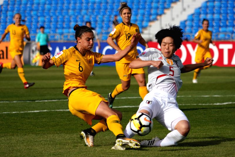 AMMAN, April 13, 2018 - Australia's Chloe Logarzo (L) vies with Japan's Nana Ichise during the group B match at the 2018 AFC Women's Asian Cup, in Amman, Jordan, April 13, 2018.