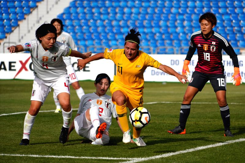AMMAN, April 13, 2018 - Australia's Lisa de Vanna (2nd R) vies for the ball during the group B match against Japan at the 2018 AFC Women's Asian Cup, in Amman, Jordan, April 13, 2018.