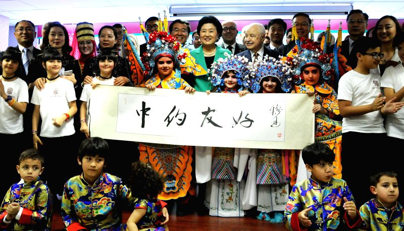 AMMAN, April 21, 2017 - Chinese Vice Premier Liu Yandong (C) visits the TAG Confucius Institute in Amman, Jordan, on April 20, 2017. China and Jordan are keen to boost ties in various fields and ...