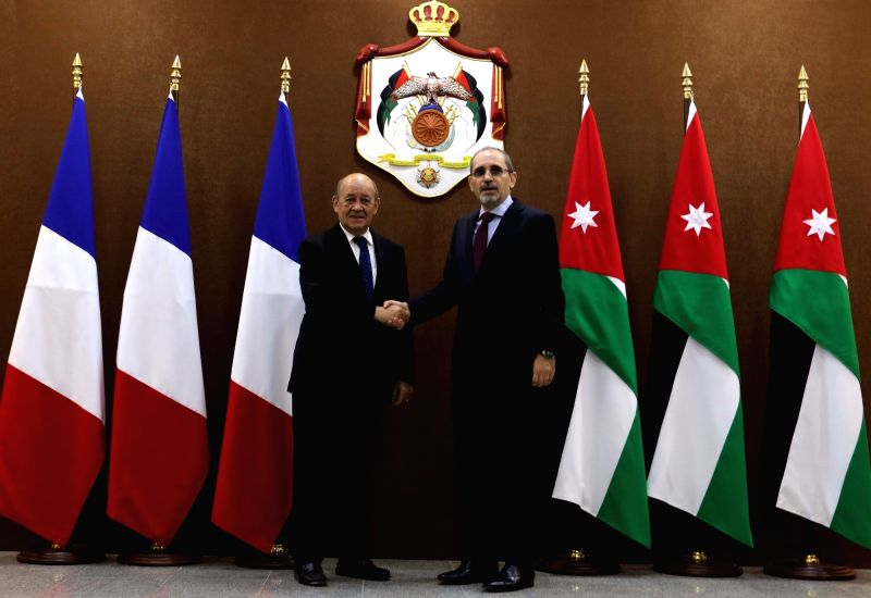 AMMAN, Aug. 2, 2018 - Jordanian Foreign Minister Ayman al-Safadi (R) shakes hands with French Foreign Affairs Minister Jean-Yves Le Drian in Amman, Jordan, on Aug. 2, 2018. - Ayman