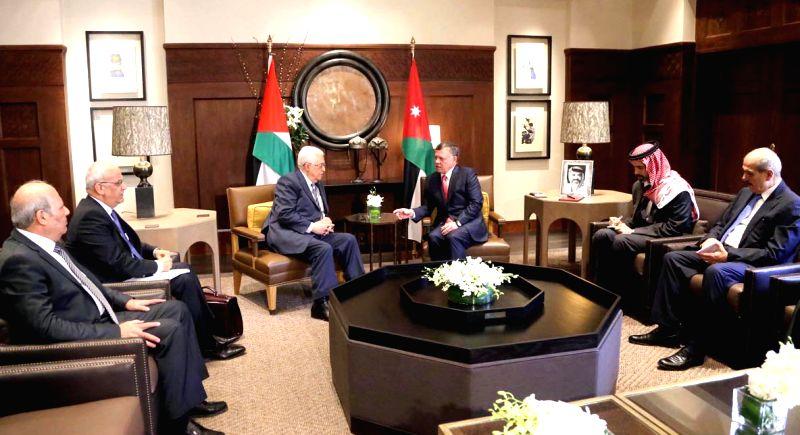 Jordanian King Abdullah II (3rd R) meets with Palestinian President Mahmoud Abbas (3rd L) in Amman, Jordan, Aug. 20, 2014. Jordanian King Abdullah II on Wednesday ...
