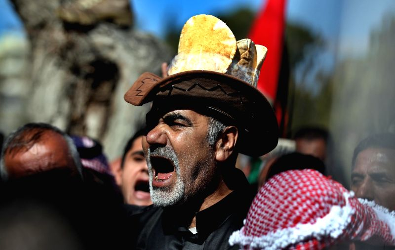AMMAN, Feb. 1, 2018 - A Jordanian shouts slogans during a protest against the government's move to hike taxes and cancel bread subsidies, in front of the Parliament of Jordan in Amman, Feb. 1, 2018.