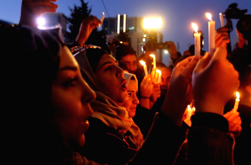 Jordanians  light candles in front of Japanese embassy in Amman on Feb. 2, 2015. Dozens of Jordanians light candles for Japanese hostages murdered by Islamic State ...