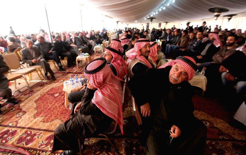 Family members of Jordanian pilot Muazth al-Kassasbeh mourn at the Aye Village in Karak, Jordan, on Feb. 4, 2015. Jordan's Lower House on Wednesday said it is ...