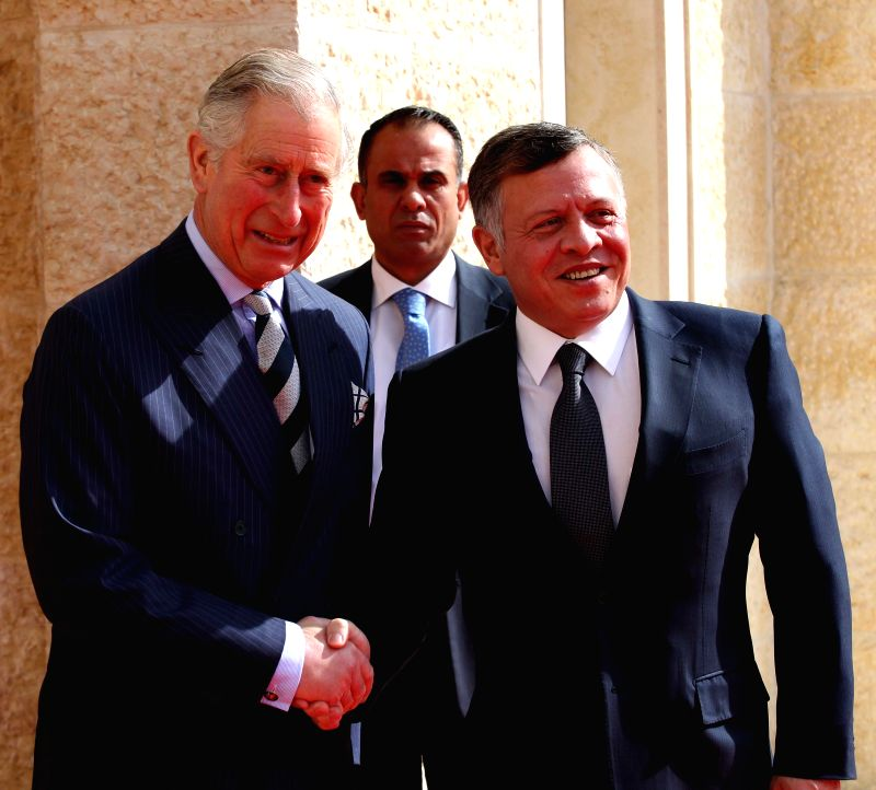 Jordan's King Abdullah II (R) greets Britain's Prince Charles (L), upon his arrival at the Royal Palace in Amman, Jordan on Feb. 8, 2015.(Xinhua/Mohammad Abu ...