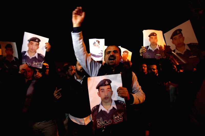 Relatives of the Jordanian pilot Muath Kasasbeh who was captured by IS protest in front of Royal Palace in Amman, Jordan, on Jan. 28, 2015. The Islamic State (IS) ...