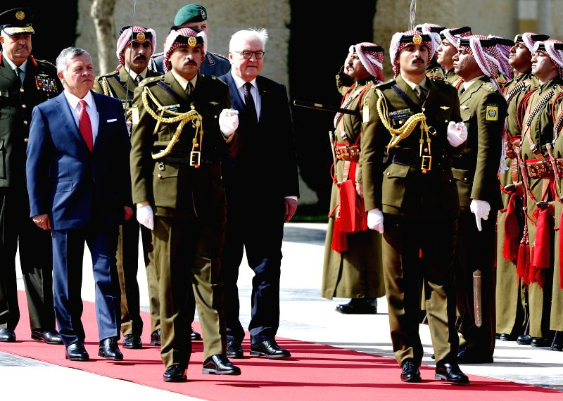 AMMAN, Jan. 28, 2018 - German President Frank-Walter Steinmeier (6th L) and King Abdullah II of Jordan (2nd L) attend a welcoming ceremony in Amman, Jordan, on Jan. 28, 2018. King Abdullah II of ...