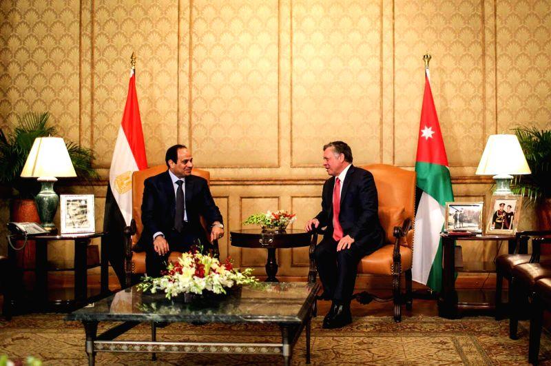 Amman (Jordan): Jordan's King Abdullah II (R) meets with Egyptian President Abdel Fattah al-Sisi in Amman, Jordan, Dec. 11, 2014.