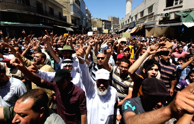 Jordanian people shout slogans during a protest against Israeli air strikes on Gaza in front of Al-Husseini Mosque in Amman, Jordan, July 18, 2014.