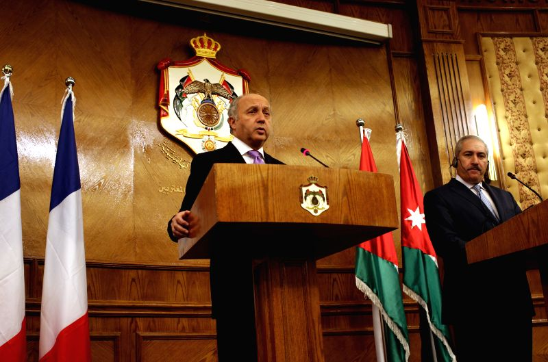 French Foreign Minister Laurent Fabius speaks during a joint press conference with his Jordanian counterpart Nasser Judeh (R) in Amman, Jordan, on July 19, 2014.