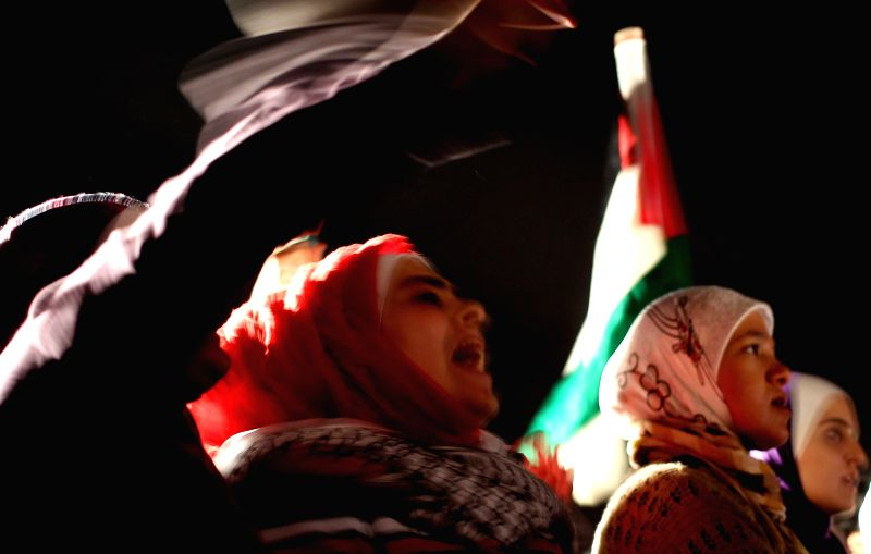 Jordanians hold a protest against Israeli airstrikes on the Gaza Strip, near the Israeli Embassy in Amman July 20, 2014.