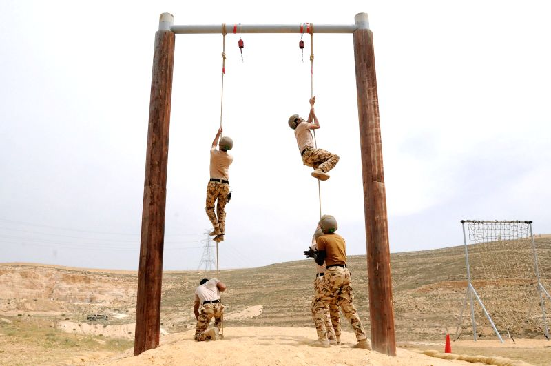 "AMMAN, May 1, 2017 - Soldiers participate in the ""death run"" match on the second day of the Ninth Annual Warrior Competition at the King Abdullah II Special Operations Training Center in ..."