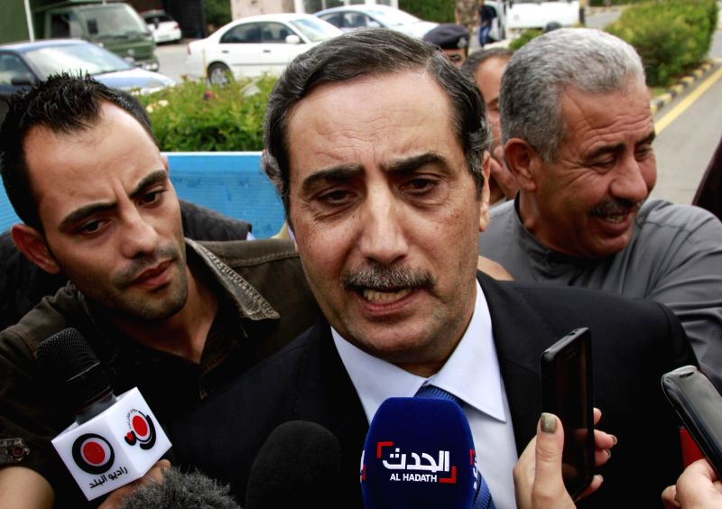 Photo: Photo: Photo: Jordan's Ambassador to Libya Fawwaz Eitan (C) speaks to reporters upon his arrival at the Marka Airbase in Amman, Jordan, May 13, 2014. The ...