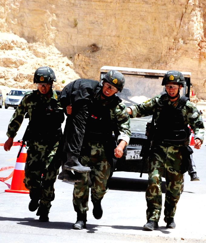 Chinese competitors take part in the 6th annual Warrior Competition at the King Abdullah II Special Operation Training Center in Amman, capital of Jordan, May 3, 2014.
