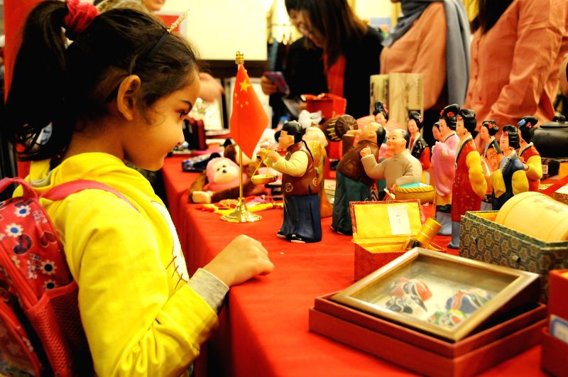 AMMAN, Oct. 7, 2017 - A child tours the stand of China at the diplomatic bazaar in Amman, Jordan, Oct. 7, 2017. The annual Diplomatic Bazaar opened here on Saturday, attracted more than fifty ...