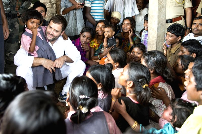 Congress vice-president Rahul Gandhi interacts with children during his padyatra in Amravati district of Maharashtra's Vidarbha region on April 30, 2015.