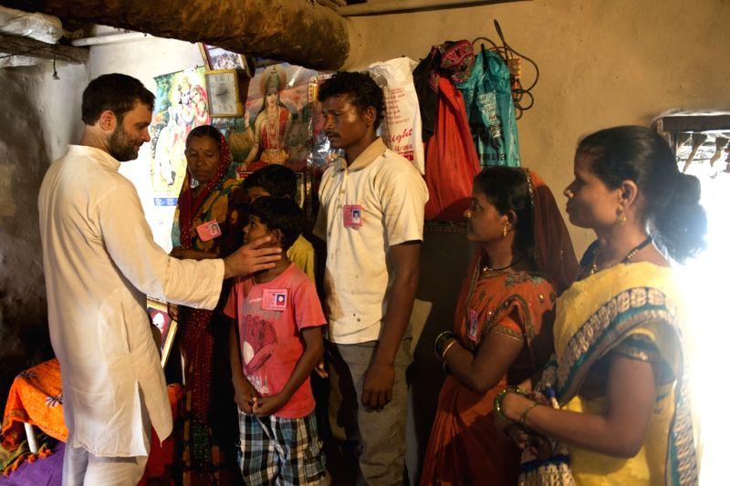 Congress vice-president Rahul Gandhi interacts with people during his padyatra in Amravati district of Maharashtra's Vidarbha region on April 30, 2015.