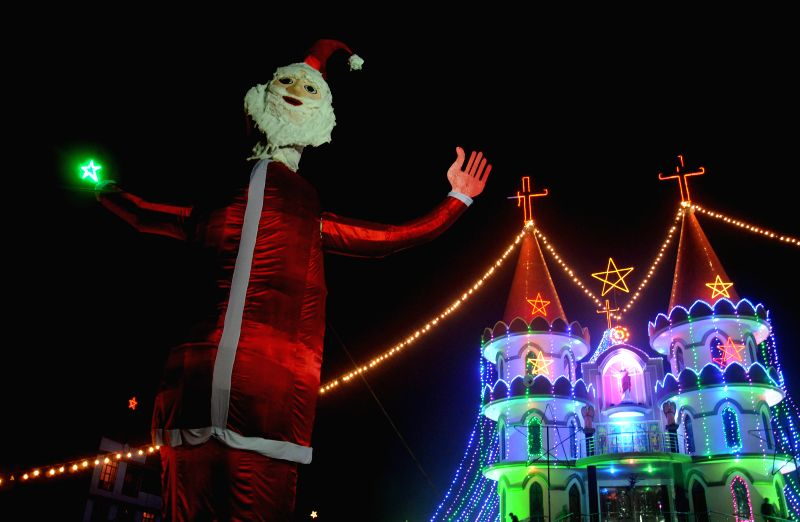 A 50-feet tall statue of Santa Claus at a church in Amritsar, on Dec 23, 2014.