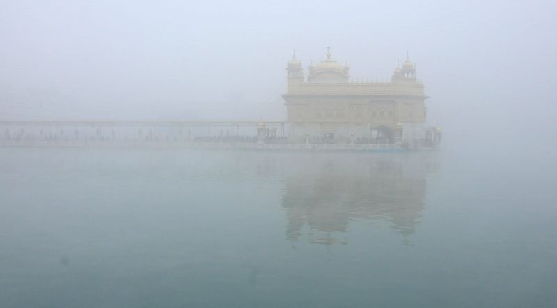 A blanket of dense fog covers the Golden Temple in Amritsar, on Dec 17, 2014.