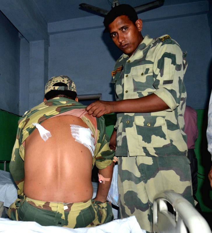A Border Security Force (BSF) trooper being treated at Guru Nanak Hospital in Amritsar who was injured in cross border firing in Amritsar sector of Punjab by smugglers from the Pakistani ...