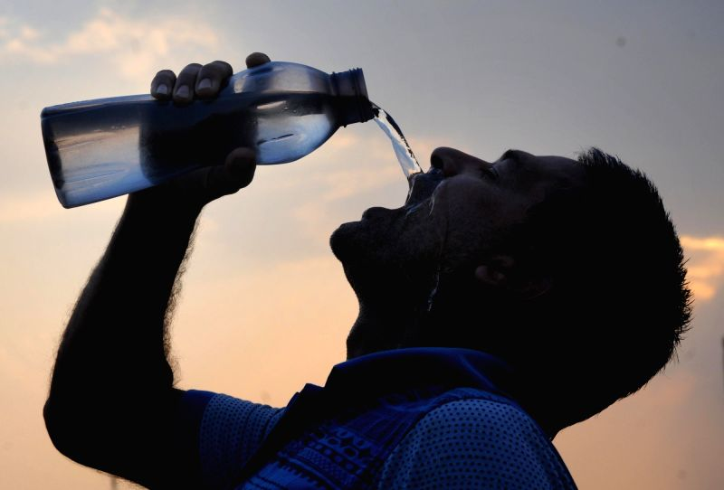 Amritsar: A man drinks water to quench his thirst as the temperatures soar to 44 degrees in Amritsar, on June 1, 2019.