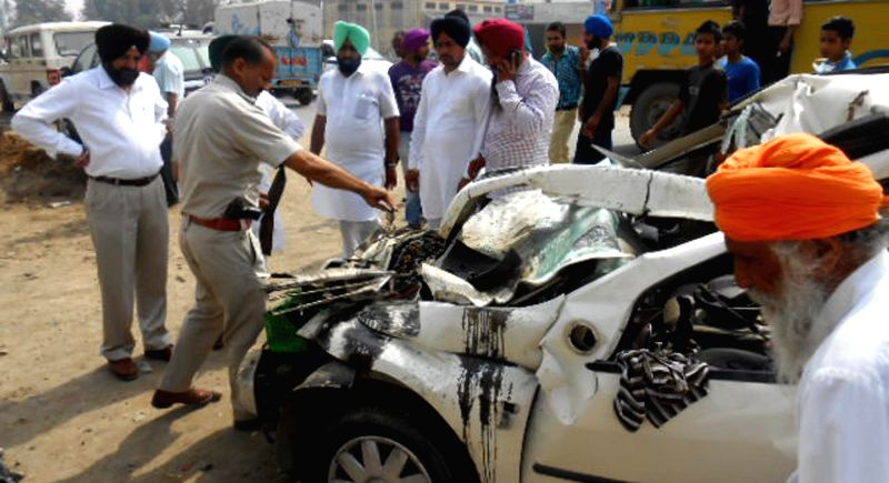 A policeman investigating at the accident site where a vehicle collided with a truck killing three persons near Amritsar, Punjab, on March 28, 2015.