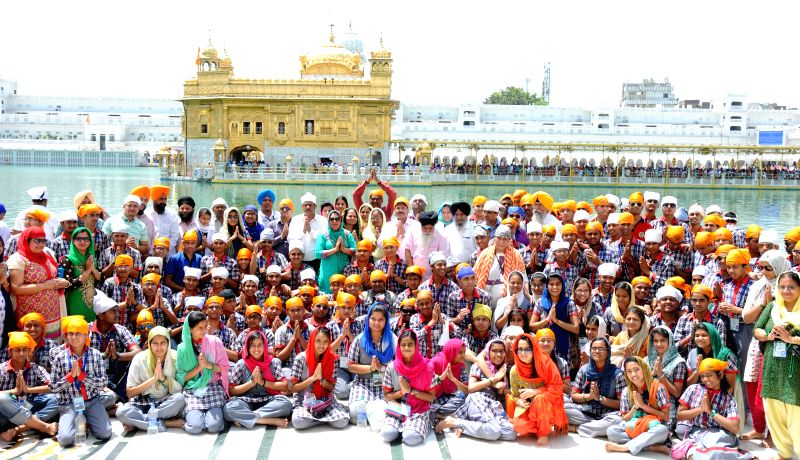 A team of Kendriya Vidyalaya students from across the nation pays obeisance at the Golden Temple in Amritsar, on April 22, 2015.