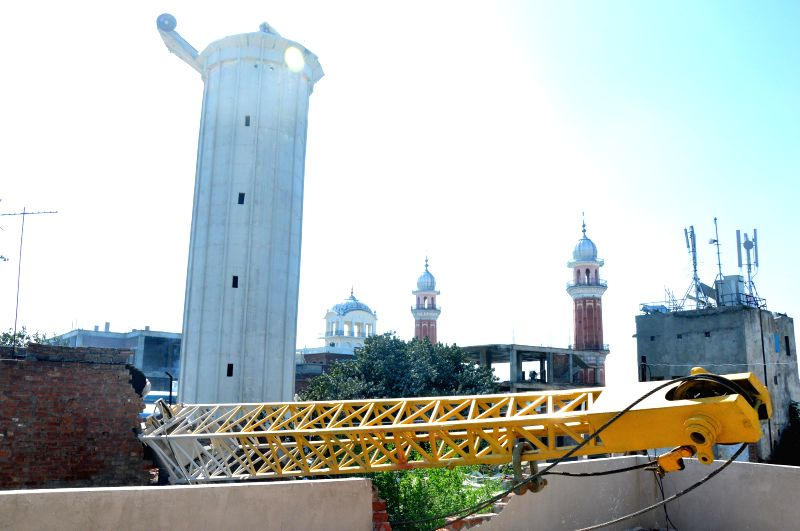 A view of damaged houses after a portion of a crane fell on the while dismantling a nearby water tank, near the Golden Temple in Amritsar on March 18, 2015.