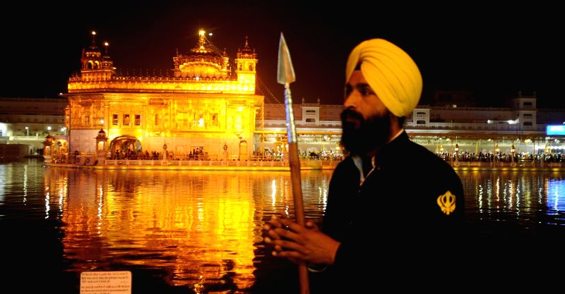 : Amritsar: A view of Golden Temple on the eve of Diwali in Amritsar, on Nov 10, 2015. The Sikh clergy and the Shiromani Gurdwara Parbandhak Committee (SGPC) decided not to mark the occasion ...