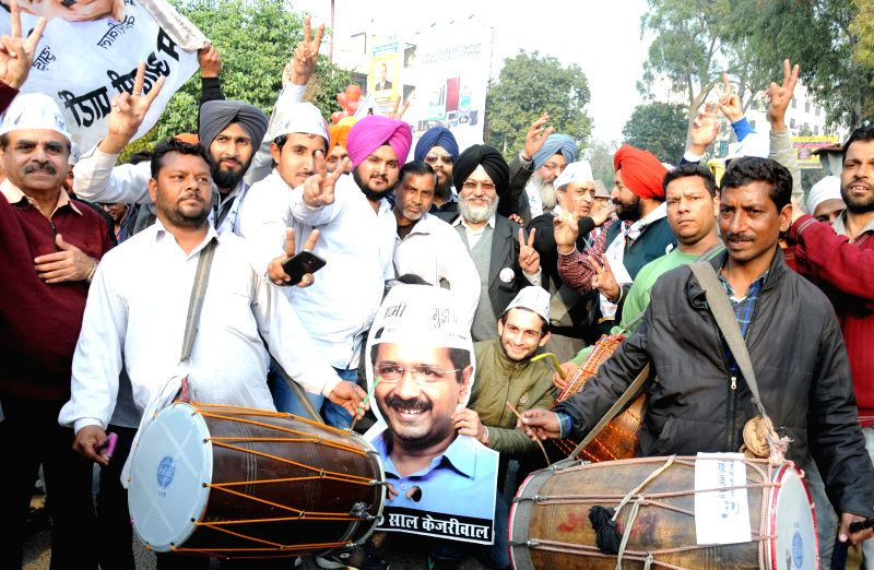 Aam Aadmi Party (AAP) workers celebrate party's victory in the recently concluded Delhi Assembly Polls in Amritsar, on Feb 10, 2015.