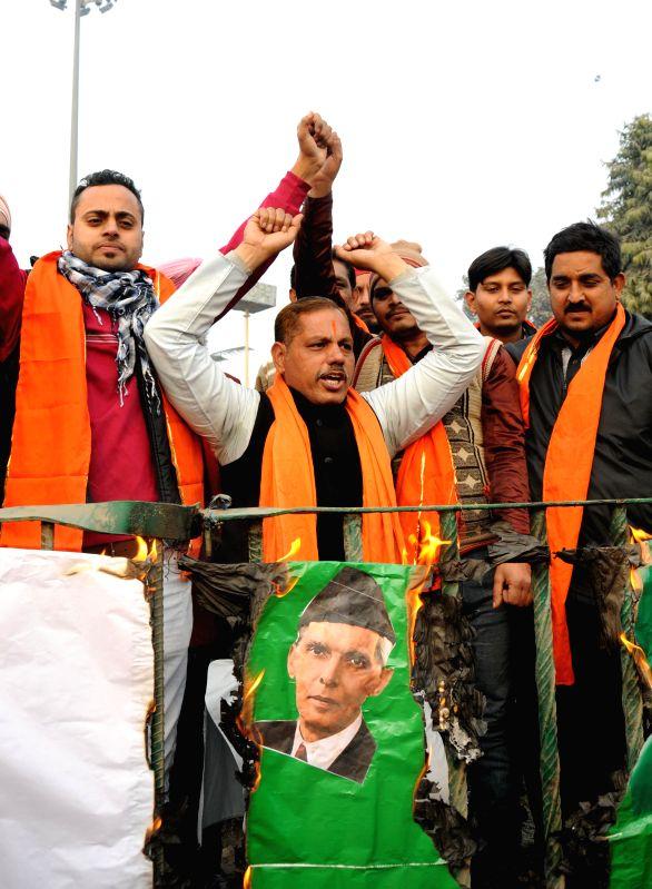 Activists of Shiv Sena Samajwadi burns the national flag of Pakistan in protest against an failed infiltration terror boat bid in India via Gujrat in Amritsar on Jan. 3, 2014.