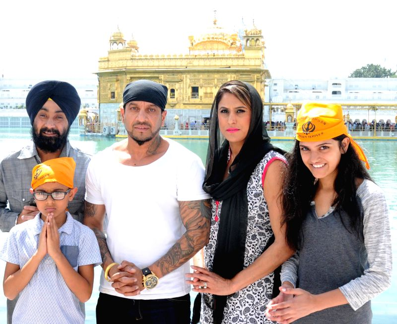 Actor-singer Jazzy B pays obeisance at the Golden Temple with his family in Amritsar, on March 25, 2015.