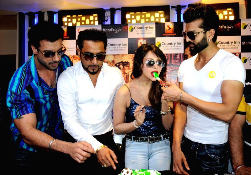 Actors Gavie Chahal, Geeta Zaildar, Rupali Sood and Yuvraj Hans during a programme organised to promote their upcoming film ``Yaarana`` in Amritsar, on April 22, 2015. - Gavie Chahal, Geeta Zaildar, Rupali Sood and Yuvraj Hans