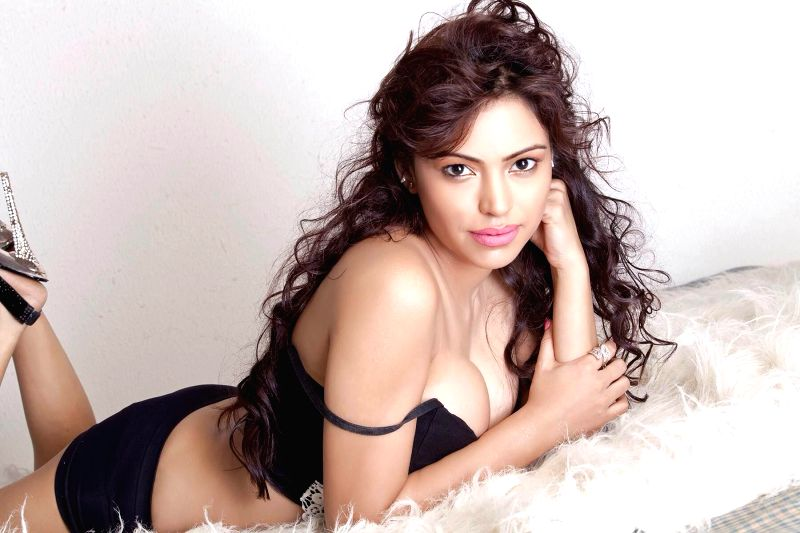 Actress and model Devshi ​K​handuri poses during a photoshoot.