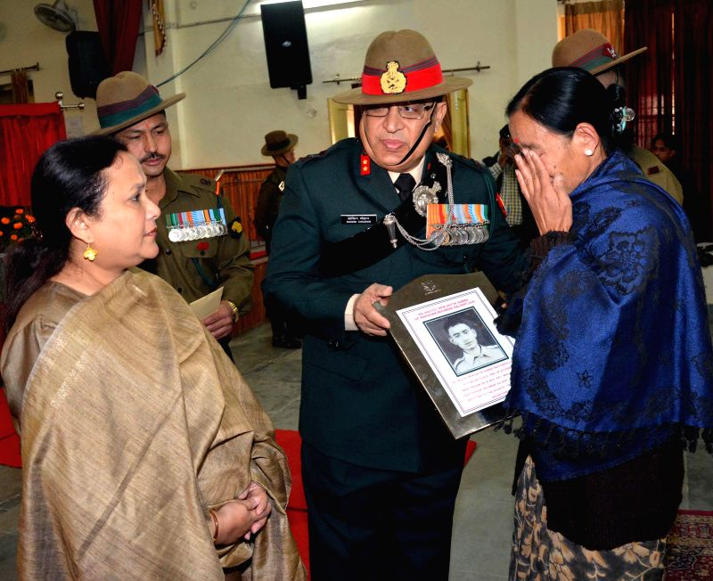 Additional Director General (public information) Major-General Shokin Chauhan presents a memento to the mother of slain Indian soldier Satya Subba the Golden Jubilee Sainik Sammelan at ... - Shokin Chauhan
