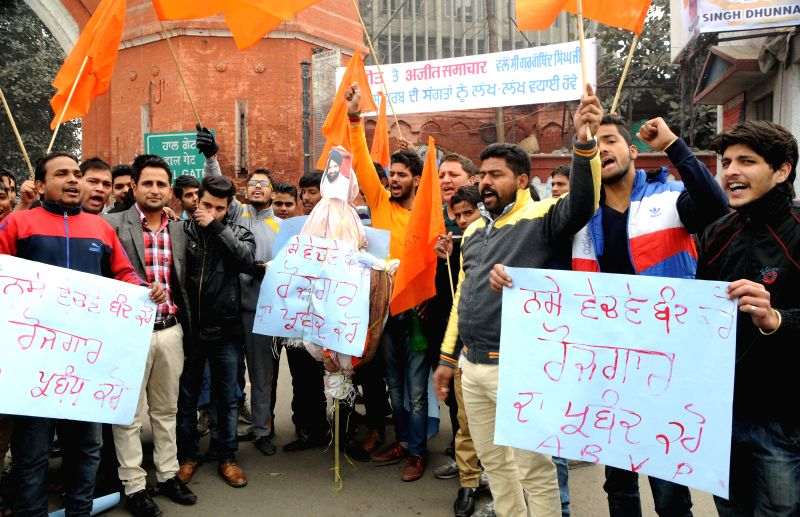 Akhil Bhartiya Vidhyarthi Parishad (ABVP) activists burn an effigy of Punjab Minister Bikram Singh Majithia who was quizzed by Enforcement Directorate (ED) in connection with his alleged ...