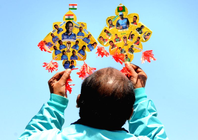Amritsar: Renowned kite-maker Jagmohan Kanojia displays his kites ahead of the ICC Wold Cup-2015 quarter-final match between India and Bangladesh,  in Amritsar on March 18, 2015.