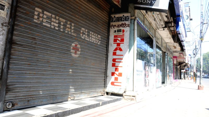 Amritsar: Shops keep their shutters down as the Radical Sikh organisation call a strike on the occasion of 31st anniversary of Operation Bluestar as ``ghallughara divas`` in Amritsar on ...