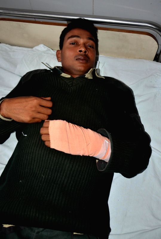 An injured Border Security Force (BSF) trooper at Guru Nanak Hospital in Amritsar who was injured in cross border firing in Amritsar sector of Punjab by smugglers from the Pakistani side at ...