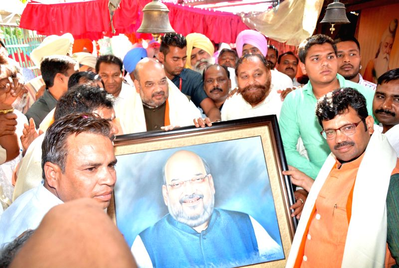 BJP chief Amit Shah pays obeisance at Ram Tirath Temple, near Amritsar, May 3, 2015.