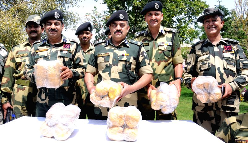 BSF officers displaying 24 kilogram of heroin recovered from smugglers in Amritsar on March 28, 2015.
