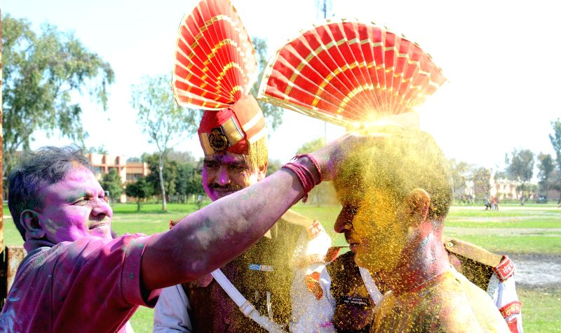 BSF soldiers celebrate Holi in Amritsar on March 6, 2015.