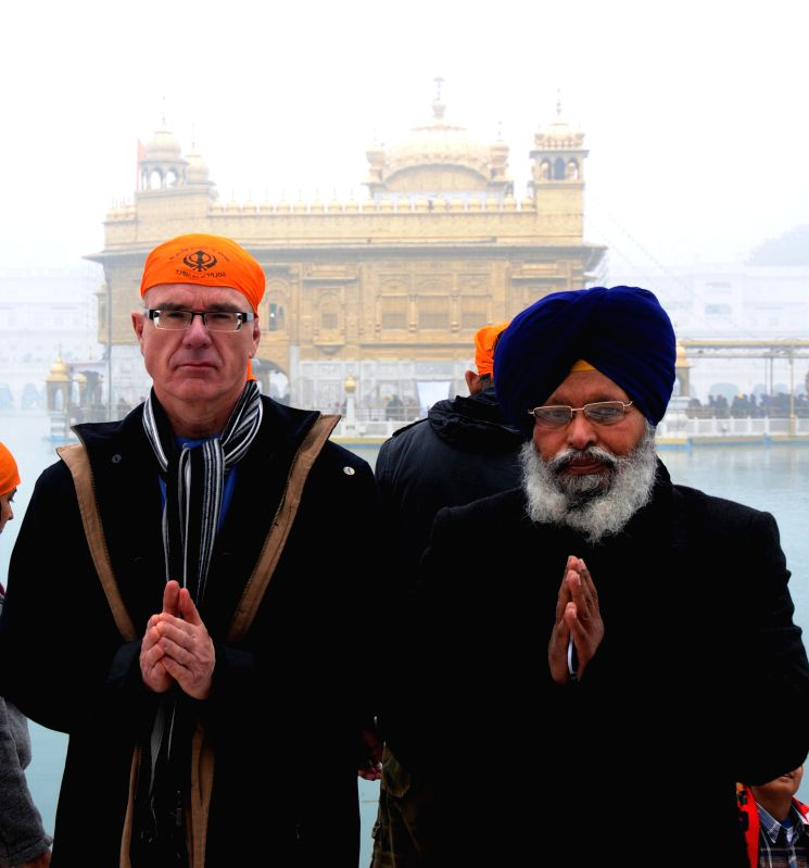Canada`s Ambassador to Norway David Sproule pays obeisence at Golden Temple in Amritsar, on Dec 27, 2014.