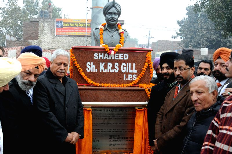 Chairman of the All-India Anti-Terrorist Front Maninderjeet Singh Bitta, Punjab minister Anil Joshi and others during the inauguration of a statue of Martyr K R Singh Gill, in Amritsar on .. - Anil Joshi